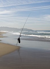 Solitary (LeftCoastKenny) Tags: fortfunston pacificocean clouds beach shore surf fishing pole