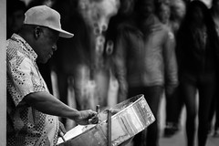 steel pan man (heavysoulclick) Tags: sanfrancisco streetphotography bw blackandwhite candid steel pan hat guitar sticks mic trees people live music canon5d 500mmlens nikoneos f8 nikon 500mm mirror reflex manual focus street photography urban city color cinematic scene dreamy movie picture