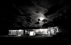 LADEKAIA at night (MoonDog (Life is Beautiful)) Tags: blackandwhite blackwhite monochrome bw night cloudy moon moonlight lights building