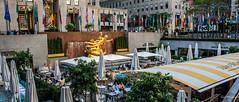 2016 - New York City - Rockefeller Center Sunken Plaza (Ted's photos - Returns late November) Tags: tedsphotos 2016 paulmanship rockefellercenter rockefellercenternyc nyc newyorkcity nikon nikonfx nikond750 cropped vignetting prometheusatrockefellercenter prometheus sculpture flags sunkenplaza umbrellas tables seating seated sitting prometheusfountain