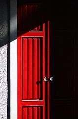 VEILED RED (Annalisa Albuzzi) Tags: minimalism light shadows colour red mistery texture trama porta door architecture architettura luce e ombre colore rosso