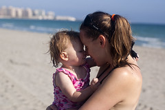 Laura and Emily cuddle on the beach (dan.oxlade) Tags: d40 nikon nikkor nikkor50mm118g beach kisses toddler mother child
