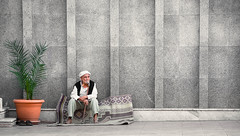 The old man and the orange pot (Chrif Benabid) Tags: man seat sit mosque prayer muslim arabic traditional old street streetphotography photojournalism outdoors pot portrait portraiture