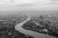 212/366 - London from the air (Spannarama) Tags: light helicopter helicopterflight aerial aerialview blackandwhite city river thames bridges shard walkietalkie cheesegrater gherkin towerbridge londonbridge hazy london uk