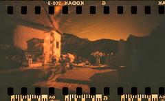 Pieve di San Pietro  (pinhole redscale) (danielesandri) Tags: pellicola carnia pinhole tina135 redscale kodak