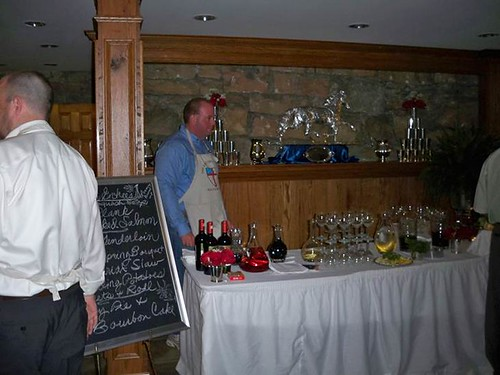 <p>James Nantz at the wine & hors d'oeuvre table, welcoming guests.</p>