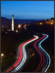 Light trails, Trehafod (mikeplonk) Tags: longexposure nightphotography red white cars windmill night train lights vanishingpoint twilight lowlight nikon mine traffic dusk curves tracks kitlens railway headlights illuminated porth rails lighttrails 1855mm windfarm taillights pacer pontypridd lighttrail windturbines sprinter rhonddaheritagepark arrivatrainswales trehafod trenauarrivacymru d5100 lewiscolliery
