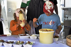 Helping out (Roving I) Tags: children sauce events festivals australia queensland noosa sunshinecoast helping foodstalls sydneyswans foodandwine plasticbuckets tackers