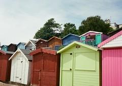 op - colourful huts (johnnytakespictures) Tags: olympus pen ee3 halfframe lomographycn400 lomo lomography analogue film walton waltononthenaze beach sea seafront ocean hut beachhuts beachut beachuts holiday