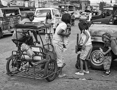 Time to Pay (Beegee49) Tags: mother children street pedicab bacolod city philippines