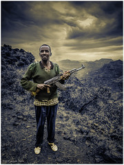 The protector of the Ethiopian Mountains (Luc V. de Zeeuw) Tags: cloudy ethiopia ethiopian kalashnikov landscape man mountain northgondar amhara