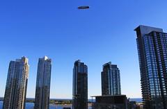 Blimp (LakeRidge Photography) Tags: toronto blimp goodyear bluejays yankees ny newyork lake ontario city skyline condos skyscrapers sunset blue sky
