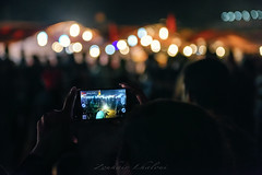 The Crowd at Jemaa el-Fnaa (Zouhair Lhaloui) Tags: jemaaelfnaa morocco maroc travelvoyage marrakech northafrica crowd placejemaaelfnaa light bokeh bokah phone screen people street streetphotography candid zouhairlhaloui zlphotography 2015 nikond810 art africa depthoffield outdoor