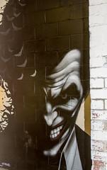 Joker in the corner (PDKImages) Tags: art artinthecity manchesterstreetgallery manchester walls murals beauty woman lady girl pretty beautiful skull butterfly bee fish chicks alone joker thejoker sinister sneer hidden ladders checks skyline birds