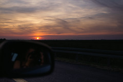 On the way back. . . (trinidalitism) Tags: canon canoneos6d sigma sigma35mmart sunset sunlight sun clouds nature ontheroad road fromthecar speed comingback traveling serbia trip vojvodina evening