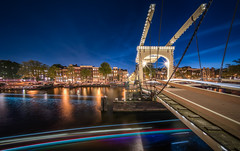 Amstel Bridge Amsterdam (hpd-fotografy) Tags: amsterdam holland netherlands architecture bluehour boat bridge center city cityscape lighttrails longexposure night nightphotography ultrawide