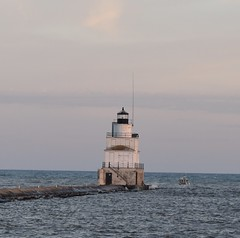 north pier light (Winged370z) Tags: boat vehicle outdoor sea lake coast guard us light lighthouse white building fedral michigan wisconsin way aid navigation law enforcement sunset sky clouds pier