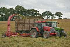 McCormick MTX120 Tractor with a JF FCT 800 Traiiler forage harvester filling a trailer drawn by a John Deere 6810 Tractor (Shane Casey CK25) Tags: mccormick mtx120 tractor jf fct 800 traiiler forage harvester filling trailer drawn john deere 6810 red green jd rathcormac silage silage16 silage2016 grass grass16 grass2016 winter feed fodder county cork ireland irish farm farmer farming agri agriculture contractor field ground soil earth cows cattle work working horse power horsepower hp pull pulling cut cutting crop lifting machine machinery nikon d7100 argo