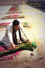 Bilawal Bhutto placing a prayer cloth on the martyrs of 21st october 2007 (GlobalCitizen2011) Tags: bilawalbhutto benazirbhutto sindh ajrak arakh sind sindhi sindhipeople sindhiclothing sindhiattire wrap block print indusvalleycivilization moen jo daro mohenjo mohenjodaro mohanjodaro larkana karsaz karachi october massacre ppp rally dubai pakistani politicians