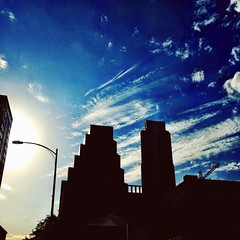 Sky Trails and Silhouettes (amitrathee) Tags: architecture austin texas silhouettes sunflare iphone5 vsco vscocam uploaded:by=flickrmobile flickriosapp:filter=nofilter
