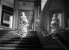 Into the light (Woodent) Tags: light bw lady streetphotography 119 ilforddelta100 minoxb ilfordlc29