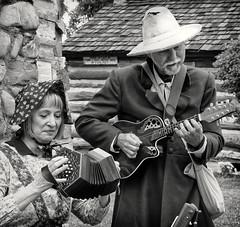 Pioneer Musicians (arbyreed) Tags: arbyreed bw pioneerday mormonpioneers utahpioneerday celebration reenactor brighamyoung provoutah utahcountyutah squareformat music makingmusic vintageinstruments happy