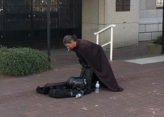 Smoke break for Kylo Ren (Ruth and Dave) Tags: kyloren streetperformer busker violinist musician character moviecharacter villain mask cloak robe victoria downtown street smoking break costume