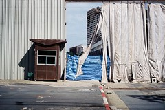 an opening (lonely radio) Tags: leicam6 leicasummicronm35mmf2typei film rangefinder thailand bangkok shadows buildings corrugated 000090