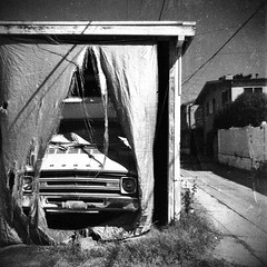 An otherwise sunny Southern California day (Dom Guillochon) Tags: urban alley people humans time life decay car vehicle vintage dodge shredded plastic curtain existence otherwise sunny southerncalifornia day noiretblanc