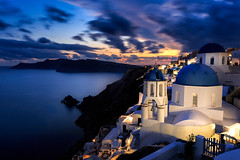 Three Blue Domes (One_Penny) Tags: aegean greece griechenland island santorin santorini canon6d travel gis oia bluehour sky clouds water silky light colors dramatic domes view caldera cityscape architecture buildings blue white thira sea mediterranean mediterraneansea houses village
