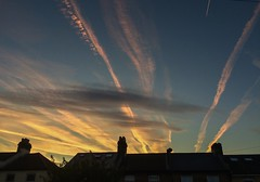 Paths of light (Boxley) Tags: aeroplane contrail cloud london eltham dawn sky house rooftop