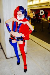 DSC_0040 (Randsom) Tags: nycc 2016 newyorkcomiccon nycomiccon javitscenter october nyc newyorkcity cosplay costume fun comicbooks comicconvention dccomics batmanfamily harleyquinn harlequin villain rogue supervillain female red blue vinyl boots asian blackhair gun wig redlips