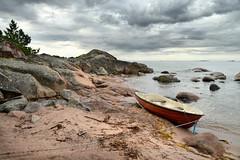 Escape (pentlandpirate) Tags: boat island shore rocks horizon finland suomi hanko granite