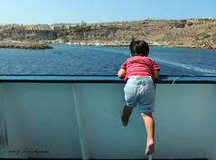 Look Dad, No Feet! (Areti Antonakopoulou) Tags: malta gozo ferry boy hanging feet