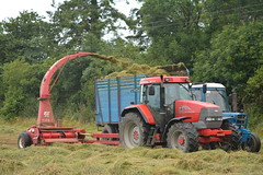 McCormick MTX120 Tractor with a JF FCT 800 Traiiler forage harvester filling a trailer drawn by a Ford 6600 Tractor (Shane Casey CK25) Tags: mccormick mtx120 tractor jf fct 800 traiiler forage harvester filling trailer drawn ford 6600 blue red rathcormac silage silage16 silage2016 grass grass16 grass2016 winter feed fodder county cork ireland irish farm farmer farming agri agriculture contractor field ground soil earth cows cattle work working horse power horsepower hp pull pulling cut cutting crop lifting machine machinery nikon d7100 argo