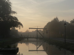 early October morn (achatphoenix) Tags: early dawn mist misty rural sunrise sun water bridge eau wasser tief movablebridge enroute unterwegs