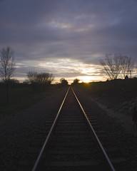 All quiet on the Western front (Electric Funeral) Tags: railroad sunset sun digital train canon photography midwest nebraska perspective railway iowa fremont kansascity railcar missouri lincoln rails kansas traincar omaha freight desmoines freighttrain councilbluffs benched benching xti