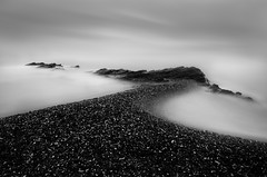 Pebble Beach (annemcgr) Tags: longexposure sea dublin seascape water monochrome clouds pebbles le malahide fineartphotography