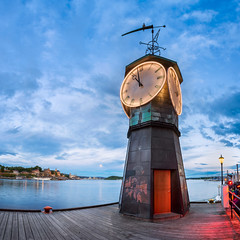 Clock Tower at Aker Brygge in Oslo, Norway (ansharphoto) Tags: aker architecture blue brygge building capital city clock cloud copper culture dusk electric embakment embankment europe european evening harbor harbour history iconic illuminated landmark lights monument night norway norwegian ocean old oslo pier port scandinavia scandinavian sea shipyard sky time tourism tower town travel twilight urban verkstedhallen watch water waterfront