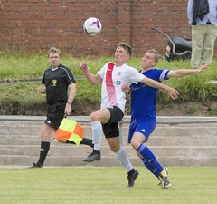 Alan Frizzell focusses on the bouncing ball as he gets in front of his man (Stevie Doogan) Tags: clydebank yoker athletic exsel group sectional league cup saturday august holm park bankies wheho juniors scotland scottish football club