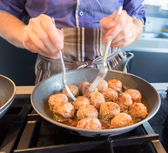 Chef turning meatballs in the frying pan (Semmick Photo) Tags: kitchen red appetizer balls beef brown chef close closeup cook cooker cooking cuisine delicious detail dinner eat flipping food forks fresh frying fryingpan gasstove gourmet ground hands healthy hub lotsof meal meat meatball meatballs mince minced natural nutrition oil pan pile pork preparation prepared raw recipe round sauteing sauteingfrying sauting seasoning snack spiced stack stove tasty turning