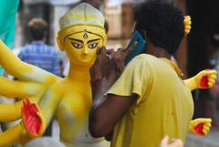 Stay connected 24x7 (Rajib Singha) Tags: travel street people art idol clay mobilephone yellow heritage culture interestingness flickriver nikond200 mfnikkor80200mmf4edlens kumartuli kolkata westbengal india