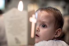Amazed (matiasrquiroga) Tags: baby baptism fire candle eyes closeup portrait