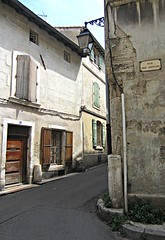 Rue des Arenes (AmyEAnderson) Tags: outdoor rue street buildings buildingcomplex shutters arles france provence bouchesdurhone corner sign architecture