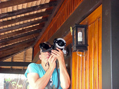 Concentrating - TNY04453 (Calle Sderberg) Tags: sony sonydsct100 thailand photographer lamp grasshopper macrophotographer bungalow leaning kohmook kohmuk