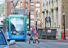 Cincinnati Streetcar (sharon'soutlook) Tags: streetcar cincinnati oh buildings pedestrian downtown dumpster streetscene urbanscene urbanphotography urban