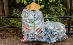 2016 - New York City - Bags Full (Ted's photos - Returns late November) Tags: 2016 cropped nikon nikond750 nikonfx nyc newyorkcity tedmcgrath tedsphotos vignetting hat railing emties collectables cans bottles cart pepsi sunkist plasticbags coke cord bungycord