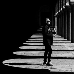 Don't Look Back (petertandlund) Tags: city light people urban blackandwhite bw man blancoynegro monochrome sunglasses contrast square pattern shadows graphic sweden stockholm cityhall columns streetphotography shades kungsholmen perspektiv xe1 graphicphoto fujix artlegacy stphotographia fotosondag skancheli fs130505