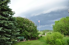 June 8, 2012 (Jeannette Greaves) Tags: sky news rain weather garden dark farm flag pole showers 2012 ctv deerwood jspubpic winnipegweather