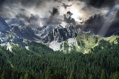 Alpine scene (Adobe Garamond) Tags: panorama montagne nuvole valle cielo neve monte rocce alto alpi pioggia luce trentino dolomiti cima raggi bosco dolomite tempesta contrasto nuvoloso bufera vetta visione abeti drammatico tempestoso pendice